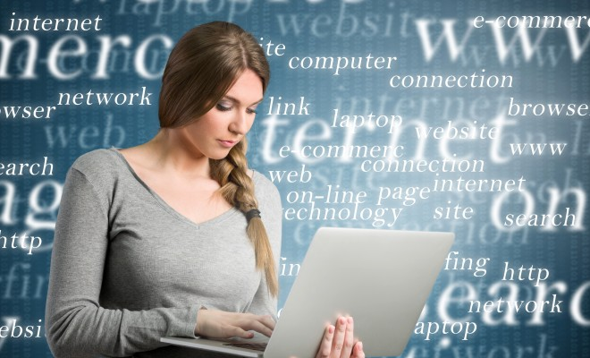 Beautiful girl using internet, holding laptop over design background