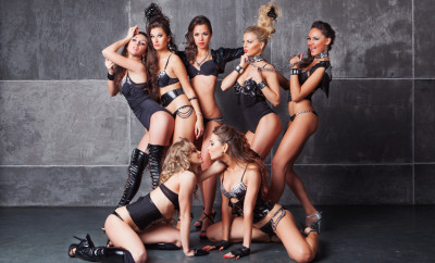 Seven Cute go-go sexy girls in black with diamonds costume playing